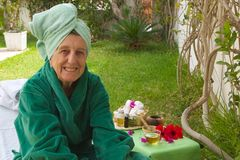 A senior in an open air spa studio Royalty Free Stock Photo