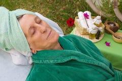 A senior in an open air spa studio Stock Photos