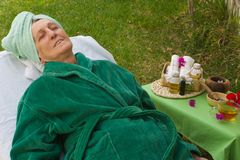 A senior in an open air spa studio Royalty Free Stock Photos
