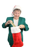 Senior Opens Christmas Stocking Stock Images