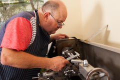 Senior operating lathe Royalty Free Stock Photo
