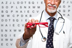 Senior ophthalmologist Stock Images