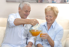 Senior orange juice. Stock Photos