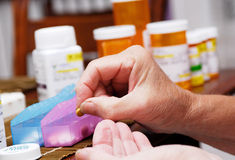 Senior organizing pill box Royalty Free Stock Image