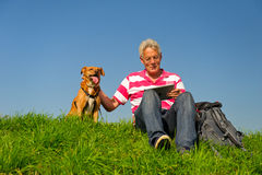 Senior outdoor with dog and tablet PC Royalty Free Stock Images