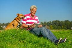 Senior outdoor with tablet PC Royalty Free Stock Photos