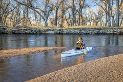 Canoe paddling on South Platte RIver royalty free stock photo