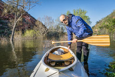 Senior paddler and expedition canoe Royalty Free Stock Image