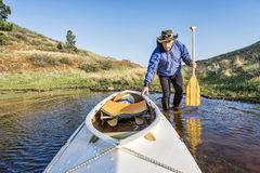 Senior paddler and expedition canoe Stock Photo