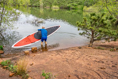 Senior paddler launching  SUP paddleboard Stock Photos