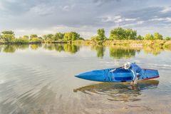 Senior paddler rinsing his stand up paddleboard Royalty Free Stock Photography