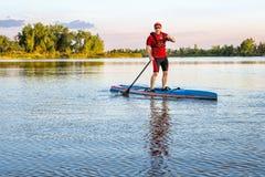 Senior paddler on stand up paddleboard Stock Photography