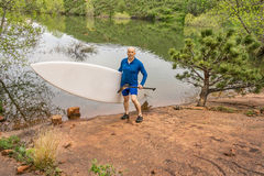 Senior paddler with SUP paddleboard Royalty Free Stock Photo