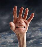 Senior Pain And Suffering. Senior pain and distress with the hand of an old retired person and a screaming suffering facial expression on the palm as a health royalty free illustration
