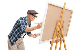 Senior painter painting on a canvas. With a paintbrush isolated on white background royalty free stock image