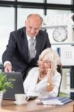 Senior pair working Royalty Free Stock Photo
