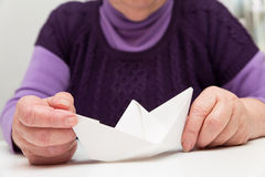 Senior with a paper boat Stock Photography