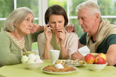 Senior parents with worried daughter Stock Images