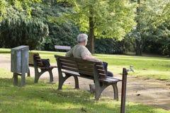 Senior in park stock photography