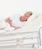 Senior Patient in bed Stock Images