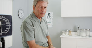 Senior patient being greeted by friendly doctor Royalty Free Stock Photo