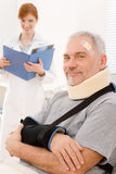Senior patient broken arm in doctor office Royalty Free Stock Photo