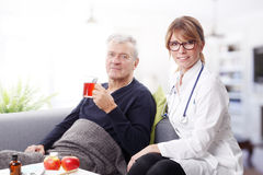 Senior patient and doctor Stock Image