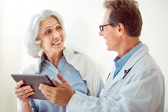 Senior patient and handsome doctor Stock Photography