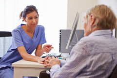 Senior Patient Having Consultation With Nurse In Office Stock Photography