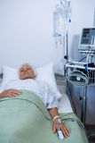 Senior patient lying on bed Royalty Free Stock Photos