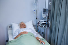 Senior patient lying on bed Royalty Free Stock Photography