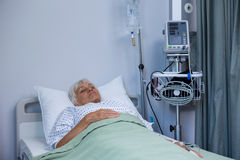 Senior patient lying on bed Stock Images