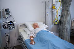 Senior patient lying on bed Stock Photos
