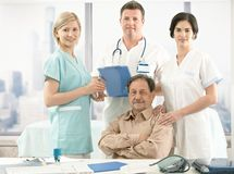Senior patient and medical team Stock Images