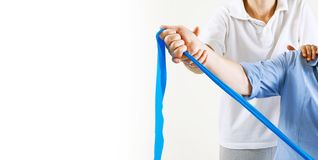 Senior patient and physiotherapist royalty free stock image