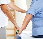 Senior patient and physiotherapist royalty free stock photo