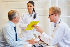 Senior patient receives advice from doctors. About therapy stock photo