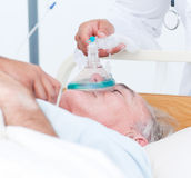 Senior patient receiving oxygen mask Royalty Free Stock Photo