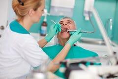 Senior patient repairing tooth Royalty Free Stock Image