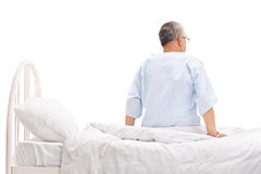 Senior patient sitting on a hospital bed Royalty Free Stock Photos