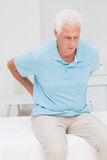 Senior patient suffering from backache Stock Photos
