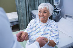 Senior patient taking assistance from the doctor. At hospital stock photos