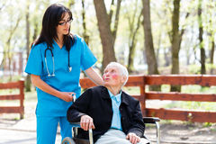 Senior Patient Talking With Kind Nurse Royalty Free Stock Photos