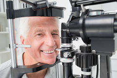 Senior patient using slit lamp at clinic Stock Image