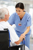 Senior patient with young doctor Royalty Free Stock Photography