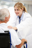 Senior patient with young female doctor Stock Photo