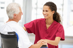 Senior patient with young female doctor Royalty Free Stock Image