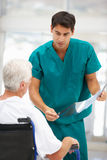 Senior patient with young male doctor Stock Photos