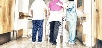 Senior patients being assisted by female asian nurse in using wa. Lker stock photo