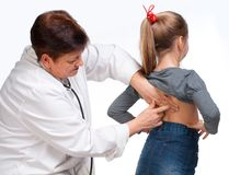 Senior pediatrician examing girl Stock Photography